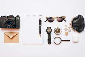 On a white background are laid out things for travel, the concept of planning and preparation photo