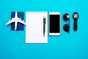 Travel objects on blue background photo