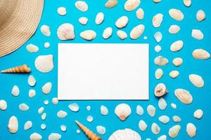 Seashells with copy space for text on blue paper background. Top view Template for your design. photo