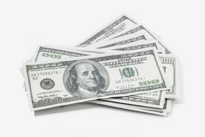 Pile of US dollar bills isolated on white background photo