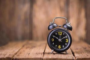 Alarm clock on wood photo