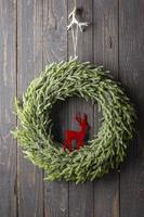 Christmas Wreath Hanging On The Door. photo