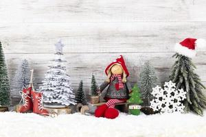 Christmas tree on wooden background. photo