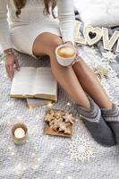 Cozy woman legs with christmas socks. photo