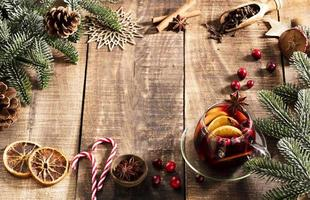 Christmas mulled wine with spices on a wooden rustic table. photo