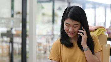 Young women talking on phone with a smiling expression. photo