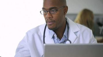 Doctor looking at x-ray in office video
