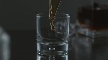Whisky is poured into glass in slow motion shot on Phantom Flex 4K at 1000 fps video