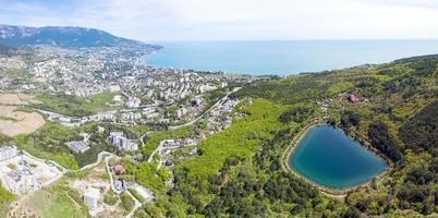Aerial view of heart shaped Mogabinskoe lake and Black Sea, Crimea. photo