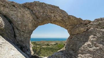 Stone arch ring of love, Crimean peninsula photo