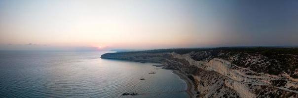 Cliff on the sunset over Kourion photo