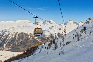 Cable cars in a ski area in the Swiss Alps photo