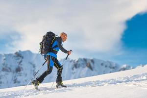 Ski mountaineering in action with seal skins photo