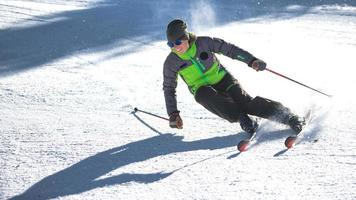 Carving curve of a girl ski instructor photo