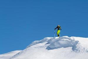 Climb with mountain skis and seal skins on a ridge photo