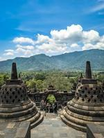 Magelang, Indonesia, 2021 - Borobudur temple with a mountain view photo