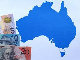 Australian banknotes and background with Australia map silhouette photo