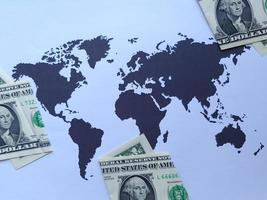 American one dollar bills and background with a world map in black and white photo