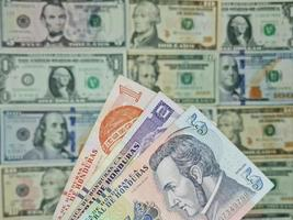 Approach to honduran banknotes and background with american dollar bills photo