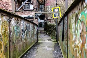 Narrow bridge to alleyway photo