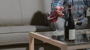 Man knocks over wine glass in slow motion shot on Phantom Flex 4K at 1000 fps video