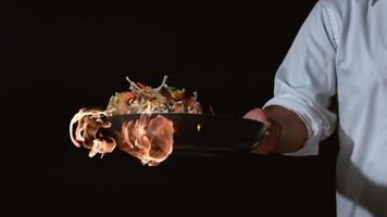Slow motion shot of chef with flaming stir fry shot on Phantom Flex 4K at 1000 fps video
