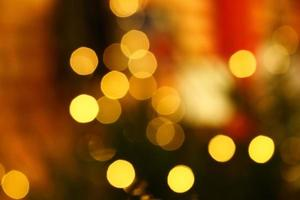 Long exposure blurred yellow christmas tree lights abstract background photo