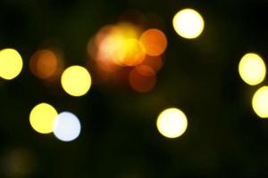 Long exposure blurred yellow and white christmas tree lights abstract background photo