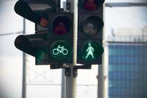 Green street light with walking feminine character photo