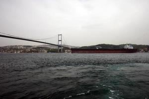 A big oil tanker passing under the bridge in the Bosphorus photo