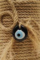 Evil eye bead made by wrapping rope photo