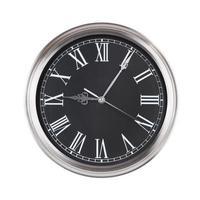 cinco minutos y nueve en una esfera de reloj foto