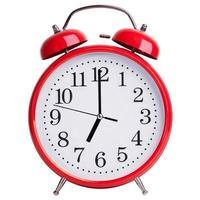 el reloj de alarma muestra exactamente las siete en punto foto