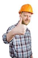 hombre con casco muestra que todo está bien foto