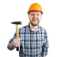hombre barbudo en un casco con martillo foto