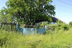 Beautiful old gate from abandoned house in village photo