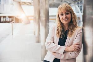 Happy beautiful smiling business woman at outside of office background. CEO manager businesswoman in formal wear suit having confidence and cheerful. People lifestyle concept. Looking at camera photo
