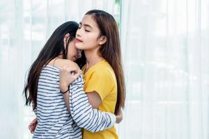 Two Asian Lesbian women looking together in bedroom. Couple people and Beauty concept. Happy lifestyles and home sweet home theme. Embracing of homosexual. Love scene making of female photo