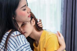 Close up of two Asian Lesbian women embracing together in bedroom. Couple people and Beauty concept. Happy lifestyles and home sweet home theme. Embracing of homosexual. Love scene making of female photo