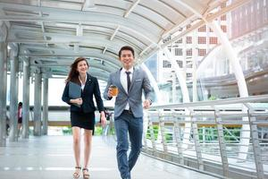 Businessman and businesswoman walking with happiness mood face, Happiness conscept, Business concept photo