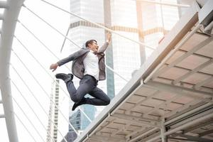 Businessman jumping in happy mood concept, Business concept, Lifestyle concept photo