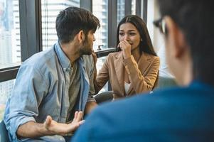 Psychotherapist inquiring about symptoms occurring within mind from couple patients with mental health problems. Group psychotherapy for support and helping worried man to change negative mindset photo