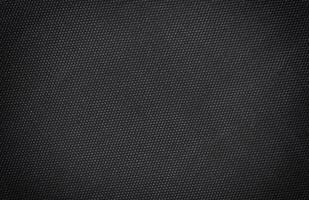 Fondo de textura de seda de lienzo de tela negra. Primer plano abstracto detalle de papel tapiz de material textil foto