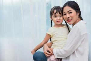 Single mom and daughter portrait. Happy family and people concept. Mother and Children day theme photo