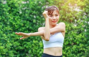 Woman exercising in the park photo