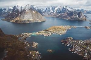 Scenic landscape of Lofoten islands - peaks, lakes, houses photo