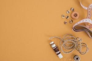 Jute thread, buttons and measuring tape photo