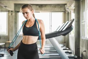 Beautiful woman with a jump rope in the gym photo
