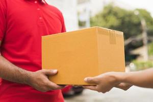 Hand accepting a delivery of boxes from deliveryman photo