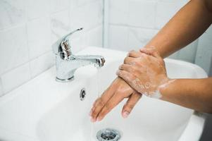 Close up male hands washing hands with soap photo